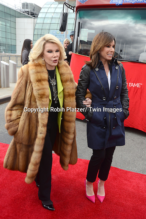 """Joan Rivers and Melissa Rivers honored by Gray Line New York with a """"Ride of Fame"""" bus with their name on a decal in the front of the bus on March 1, 2013 at Pier 78 in New York City."""