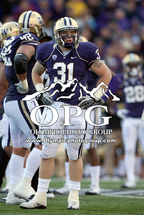 Oct 15, 2011:  Washington linebacker #31 Cort Dennison looks to the sidelines for the play against Colorado.  Washington defeated Colorado 52-24 at Husky Stadium in Seattle, Washington...