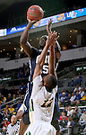 SIOUX FALLS, SD - MARCH 9: Obi Emegano #15 from Oral Roberts shoots over Lawrence Alexander #12 of NDSU in the second half of their semi-final round Summit League Championship Tournament game Monday evening at the Denny Sanford Premier Center in Sioux Falls, SD. (Photo by Dave Eggen/Inertia)
