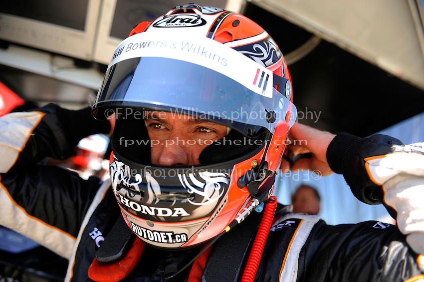 Alex Tagliani (#77) straps on his helmet.