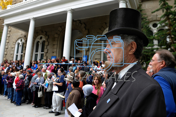 "Wally Earhart as Abe Lincoln, right, and numerous others gather on the Capitol steps Thursday, Oct. 30, 2014 for #NevadaSings!, a statewide sing-a-long of ""Home Means Nevada."" Approximately 370 people took part  in the Carson City portion of the event, which seeks to establish a new record for the most people in an American state to sing their state song at the same time."