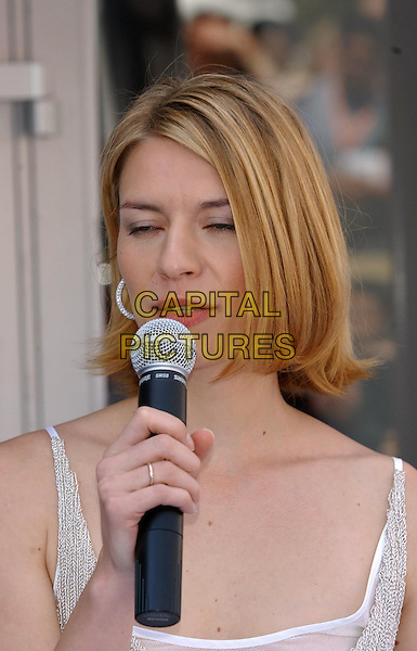 CLAIRE DANES.opens the American Pavillion.Cannes Film Festival 2003.www.capitalpictures.com.sales@capitalpictures.com.©Capital Pictures.eyes closed, funny