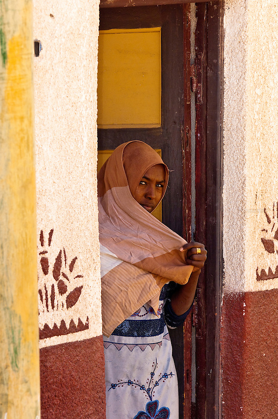 Woman covered by veil, Nubian village near Aswan, Egypt