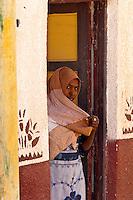Woman covered by veil, Nubian village near Aswan, Egypt