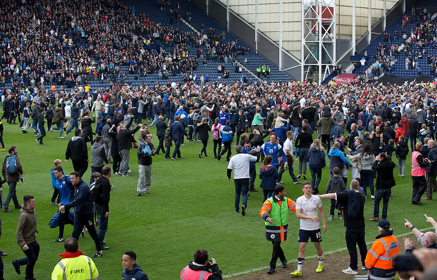 Preston North End's Calum Woods makes his get-a-away to the dressing rooms as fans invaded the pitch at the final whistle<br /> <br /> Photographer Stephen White/CameraSport<br /> <br /> Football - The Football League Sky Bet League One Semi-Final Second Leg - Preston North End -  Chesterfield - Deepdale - Preston<br /> <br /> &copy; CameraSport - 43 Linden Ave. Countesthorpe. Leicester. England. LE8 5PG - Tel: +44 (0) 116 277 4147 - admin@camerasport.com - www.camerasport.com