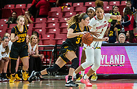 COLLEGE PARK, MD - FEBRUARY 13: Makenzie Meyer #3 of Iowa drives past Shakira Austin #1 of Maryland during a game between Iowa and Maryland at Xfinity Center on February 13, 2020 in College Park, Maryland.