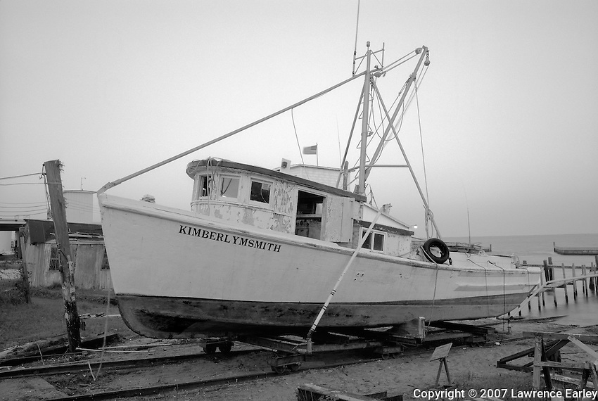 James Gillikin of Harkers Island built the KIMBERLY M. SMITH (right) in 1977 as a run boat for the Luther Smith Seafood Co. of Atlantic.  She runs fish from the nets of the few long-haul fishermen who still operate in Core Sound.