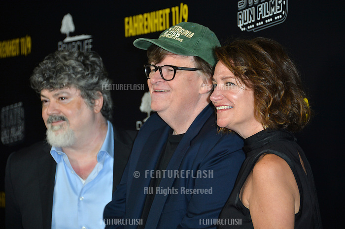"LOS ANGELES, CA. September 19, 2018: Michael Moore, Carl Deal & Meghan O'Hara at the Los Angeles premiere for Michael Moore's ""Fahrenheit 11/9"" at the Samuel Goldwyn Theatre.<br /> Picture: Paul Smith/Featureflash"