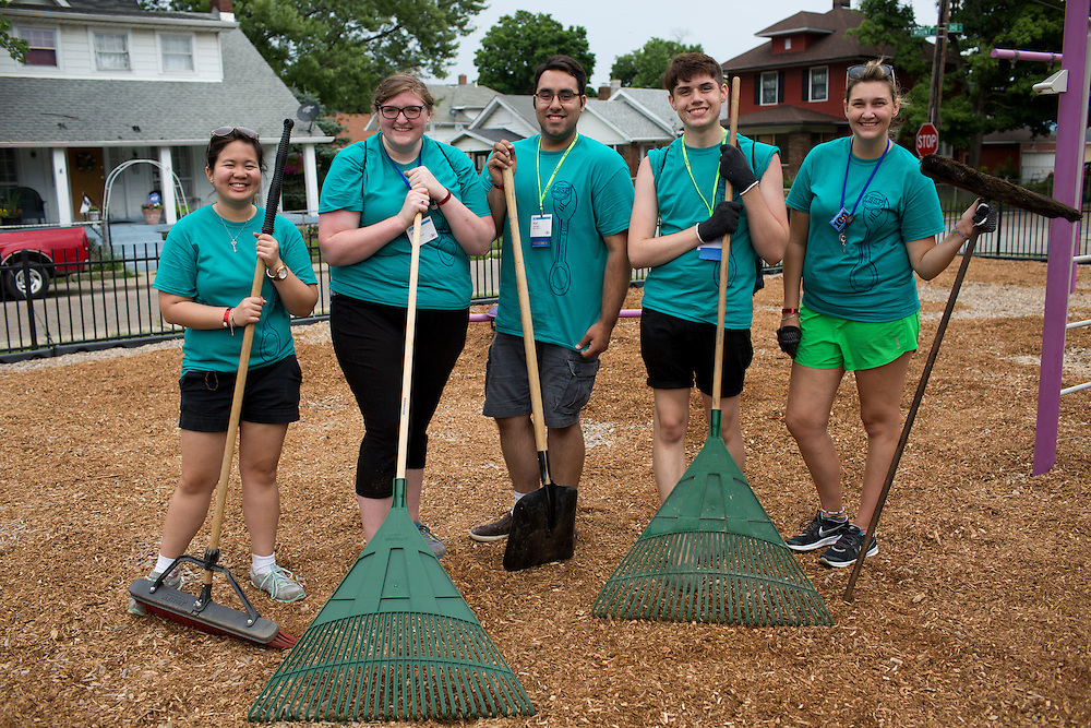 """Members pose for a photo at the Hawthorne Center for Working Families during """"Circle the City with Service,"""" the Kiwanis Circle K International's 2015 Large Scale Service Project, on Wednesday, June 24, 2015, in Indianapolis. (Photo by James Brosher)"""