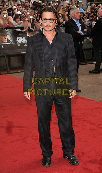 JOHNNY DEPP.European Premiere of 'Public Enemies' at the Empire Cinema, Leicester Square, London, England..June 29th 2009.full length suit jacket waistcoat glasses pinstripe black trousers suit.CAP/CAN.©Can Nguyen/Capital Pictures.