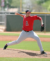 Garrett Richards #77 of the Los Angeles Angels pitches in a minor league spring training game against the Colorado Rockies at the Angels minor league complex on March 18, 2011  in Tempe, Arizona. .Photo by:  Bill Mitchell/Four Seam Images.