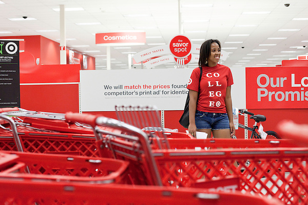 August 20, 2011. Chapel Hill, NC.. Porscha Armwood, a UNC student hired by Target, hands out freebies to other students brought from the UNC campus by Target chartered buses on campus move in day. The company hired the buses and staged sales to encourage students to buy items in the store that they might need for their dorm rooms.. Many companies have increased their efforts to reach the youth market by employing popular college students to raise the awareness of the brand by peer to peer marketing on campus' around the country.