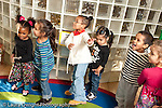 Education preschool 3-4 year olds movement music time group of active children horizontal hand movements and gestures