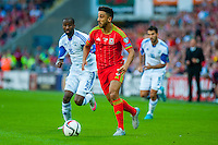 Eliazer Dasa of Isreal chases Neil Taylor of Wales during their UEFA EURO 2016 Group B qualifying round match held at Cardiff City Stadium, Cardiff, Wales, 06 September 2015. EPA/DIMITRIS LEGAKIS