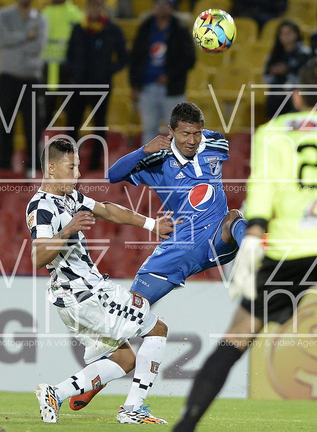 BOGOTÁ -COLOMBIA, 02-08-2014. Luis Mosquera (Der.) jugador de Millonarios disputa el balón con Johan Jaramillo (Izq.) jugador de Boyacá Chicó FC durante partido por la fecha 3 de la Liga Postobón II 2014 jugado en el estadio Nemesio Camacho el Campín de la ciudad de Bogotá./ Luis Mosquera (R) player of Millonarios fights for the ball with Johan Jaramillo (L) player of Boyaca Chico FC during the match for the third date of the Postobon League II 2014 played at Nemesio Camacho El Campin stadium in Bogotá city. Photo: VizzorImage/ Gabriel Aponte / Staff