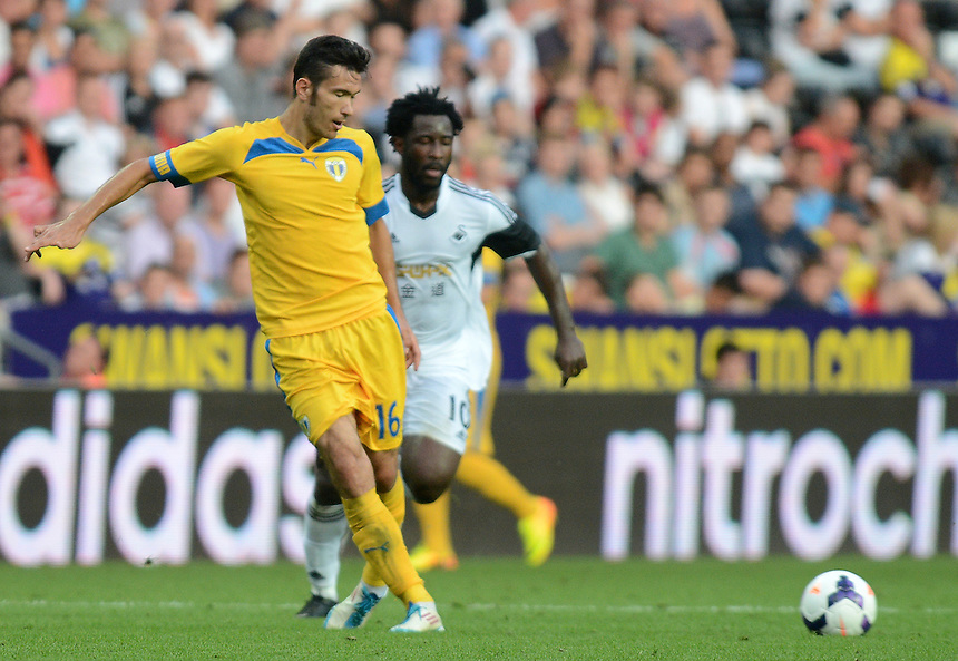 Petrolul Ploiesti's Alexandru Benga is put under pressure from Swansea City's Wilfried Bony<br /> <br /> (Photo by Ian Cook/CameraSport)<br /> <br /> Football - UEFA Europa League Qualifying Play-off First leg - Swansea City v Petrolul Ploiesti - Thursday 22nd August 2013 - The Liberty Stadium - Swansea<br /> <br /> &copy; CameraSport - 43 Linden Ave. Countesthorpe. Leicester. England. LE8 5PG - Tel: +44 (0) 116 277 4147 - admin@camerasport.com - www.camerasport.com
