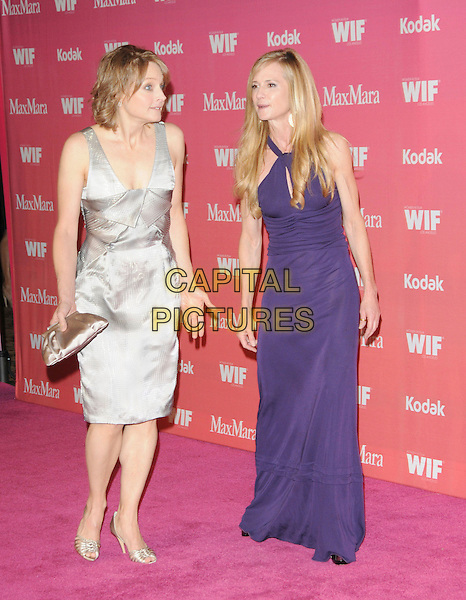 JODIE FOSTER & HOLLY HUNTER .at The Women in Film 2009 Crystal .and Lucy Awards held at The Hyatt Regency Century Plaza in Century City, California, USA, June 12th 2009                                                                     .full length grey gray silver dress purple long maxi gold shoes clutch bag  .CAP/DVS.©Debbie VanStory/RockinExposures/Capital Pictures