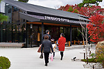 People going to Starbucks Coffee, American fast food restaurant chain coffeehouse in Uji, Kyoto Prefecture, Japan 2017