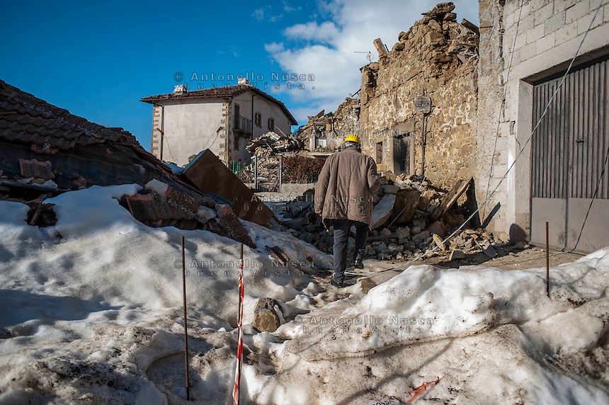 Amatrice, Italy, February 13, 2017. A man walks between destroyed houses at Capriccio, hamlet of Amatrice, Six months after the earthquake, nothing has changed. The rubble is still there; nothing has been moved, recorded or stored. People are still living in provisional accommodation but the greatest loss, to many residents, is the loss of their former peaceful lives.