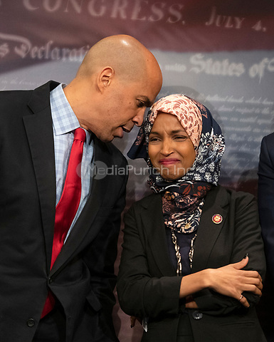 United States Senator Cory Booker (Democrat of New Jersey) and US Representative Ilhan Omar (Democrat of Minnesota) converse during a press conference in the US Capitol in Washington, DC announcing a Democratic package of three bills to be introduced in the US Senate and US House to control prescription drug prices on Thursday, January 10, 2019.<br /> Credit: Ron Sachs / CNP /MediaPunch