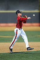 Louisville Cardinals shortstop Lucas Dunn (39) makes a throw to first base during infield practice prior to the game against the Wake Forest Demon Deacons at David F. Couch Ballpark on March 17, 2018 in  Winston-Salem, North Carolina.  The Cardinals defeated the Demon Deacons 11-6.  (Brian Westerholt/Four Seam Images)