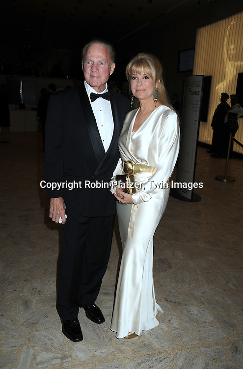 "Frank Gifford and wife Kathie Lee Gifford in Ralph Lauren white dress posing for photographers at the 26th Annual Literacy Partners Gala with Star-Studded ""Evening of Readings""  on May 10. 2010 at The Koch Theatre at Lincoln Center in New York City."