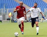 Calcio, Serie A: Roma vs Cagliari. Roma, stadio Olimpico, 21 settembre 2014.<br /> Roma defender Maicon, of Brazil, is challenged by Cagliari midfielder Joao Dos Santos Galvao, also of Brazil, right, during the Italian Serie A football match between AS Roma and Cagliari at Rome's Olympic stadium, 21 September 2014.<br /> UPDATE IMAGES PRESS/Riccardo De Luca