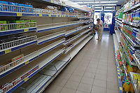 Shelves emptying out in Volnovakha, Ukraine amid fears of fighting. September, 2014.