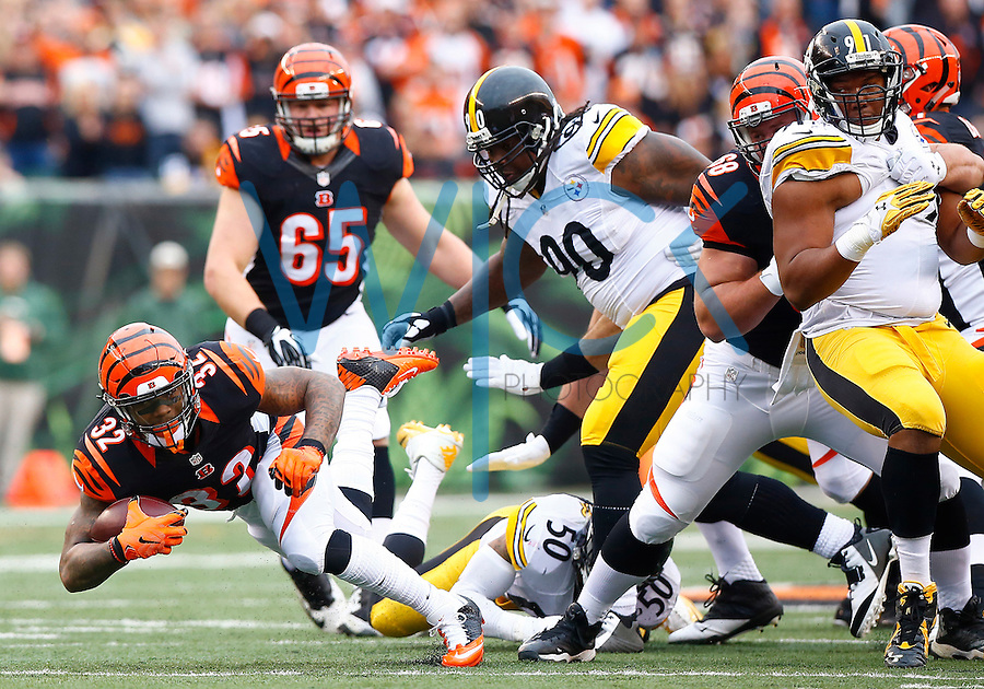Jeremy Hill #32 of the Cincinnati Bengals is tackled by Ryan Shazier #50 of the Pittsburgh Steelers in the first quarter during the game at Paul Brown Stadium on December 12, 2015 in Cincinnati, Ohio. (Photo by Jared Wickerham/DKPittsburghSports)