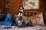 Sandy Viguers rests with Mikki, a Black Cap Capuchin monkey.  Dave and Sandy Viguers live with monkeys at their home outside of Lampasas, Texas.  February 22, 2009.