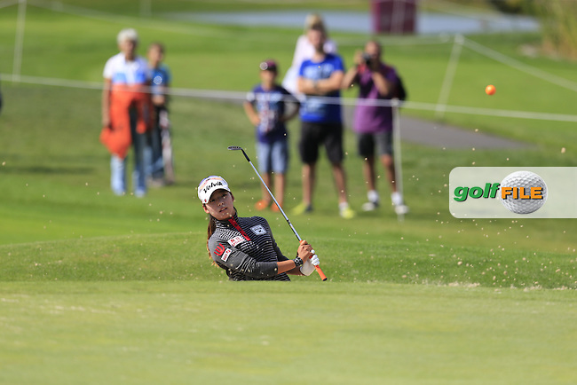 Mi Hyang Lee (KOR) chips from a bunker at the 15th green during Sunday's Final Round of the LPGA 2015 Evian Championship, held at the Evian Resort Golf Club, Evian les Bains, France. 13th September 2015.<br /> Picture Eoin Clarke | Golffile