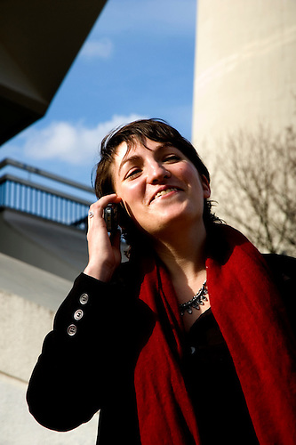 Woman chats on her mobile phone