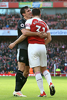 Burnley's Jack Cork embraces Arsenal's Sead Kolasinac<br /> <br /> Photographer David Shipman/CameraSport<br /> <br /> The Premier League - Arsenal v Burnley - Saturday 22nd December 2018 - The Emirates - London<br /> <br /> World Copyright © 2018 CameraSport. All rights reserved. 43 Linden Ave. Countesthorpe. Leicester. England. LE8 5PG - Tel: +44 (0) 116 277 4147 - admin@camerasport.com - www.camerasport.com