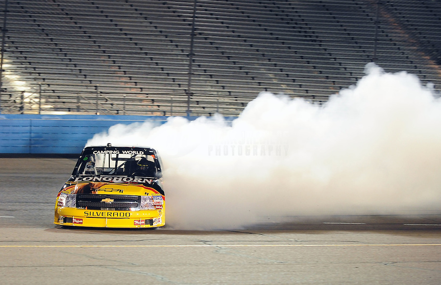Nov. 13, 2009; Avondale, AZ, USA; NASCAR Camping World Truck Series driver Kevin Harvick spins in turn four during the Lucas Oil 150 at Phoenix International Raceway. Mandatory Credit: Mark J. Rebilas-