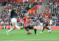 Southampton's Wesley Hoedt clears the ball despite the attentions of Burnley's Chris Wood<br /> <br /> Photographer Kevin Barnes/CameraSport<br /> <br /> The Premier League - Southampton v Burnley - Sunday August 12th 2018 - St Mary's Stadium - Southampton<br /> <br /> World Copyright &copy; 2018 CameraSport. All rights reserved. 43 Linden Ave. Countesthorpe. Leicester. England. LE8 5PG - Tel: +44 (0) 116 277 4147 - admin@camerasport.com - www.camerasport.com