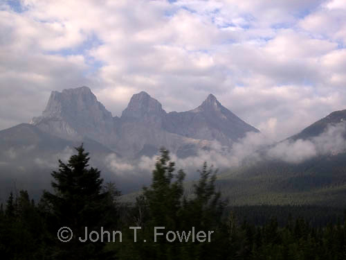 Three Sisters Mountain peaks in Rocky Mountains near Banff, Alberta, Canada