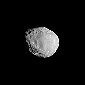 Saturn's moon Janus shows the scars of impacts in this Cassini spacecraft image of craters light and dark. This view looks toward the Saturn-facing side of Janus (179 kilometers, or 111 miles across). North on Janus is up and rotated 10 degrees to the right. The image was taken in visible light with the Cassini spacecraft narrow-angle camera on April 7, 2010. The view was acquired at a distance of approximately 75,000 kilometers (47,000 miles) from Janus and at a sun-Janus-spacecraft, or phase, angle of 39 degrees. Image scale is 448 meters (1,469 feet) per pixel..Credit: NASA/JPL/Space Science Institute via CNP