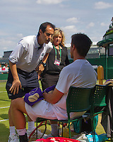 29-06-13, England, London,  AELTC, Wimbledon, Tennis, Wimbledon 2013, Day six, Igor Sijsling (NED) calls for the doctor after his fall and he feels sick<br /> <br /> <br /> <br /> Photo: Henk Koster