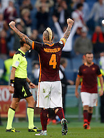 Calcio, Serie A: Roma vs Lazio. Roma, stadio Olimpico, 8 novembre 2015.<br /> Roma's Radja Nainggolan celebrates at the end of the Italian Serie A football match between Roma and Lazio at Rome's Olympic stadium, 8 November 2015. Roma won 2-0.<br /> UPDATE IMAGES PRESS/Riccardo De Luca