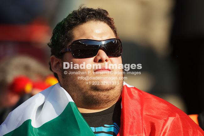 JOHANNESBURG, SOUTH AFRICA - JUNE 24:  An Italy supporter drapes a flag across his shoulders at the FIFA World Cup Group F match between Italy and Slovakia at Ellis Park Stadium on June 24, 2010 in Johannesburg, South Africa.  Editorial use only.  Commercial use prohibited.  No push to mobile device usage.  (Photograph by Jonathan Paul Larsen)