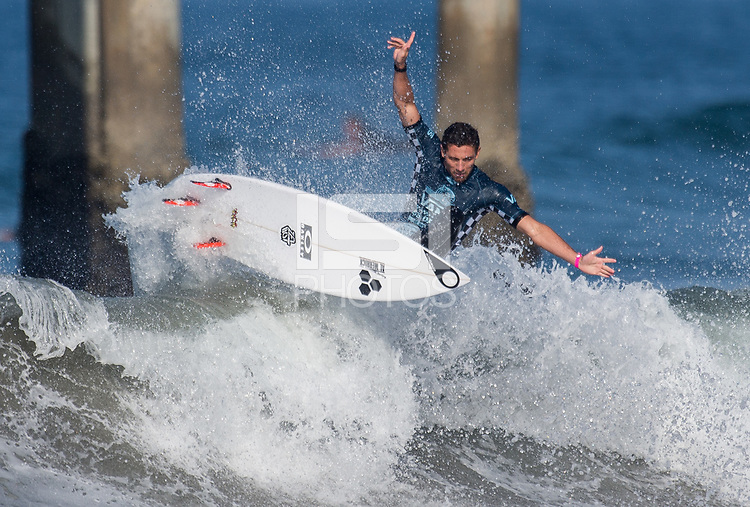 Huntington Beach, CA - Tuesday July 31, 2018: Jorgann Couzinet in action during a World Surf League (WSL) Qualifying Series (QS) Men's round of 96 heat at the 2018 Vans U.S. Open of Surfing on South side of the Huntington Beach pier.