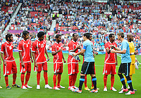 July 26, 2012..Players during pregame hand shale before UAE vs Uruguay Football match during 2012 Olympic Games at Old Trafford in Manchester, England. Uruguay defeat United Arab Emirates 2-1...