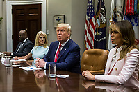 U.S. President Donald Trump speaks during an opioid round table at the White House in Washington, DC, USA, 12 June 2019. Also pictured are White House Counselor Kellyanne Conway and U.S. First Lady Melania Trump.<br /> Credit: Zach Gibson / Pool via CNP/AdMedia