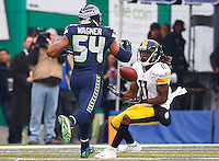 Markus Wheaton #11 of the Pittsburgh Steelers catches a pass in front of Bobby Wagner #54 of the Seattle Seahawks during the game at CenturyLink Field on November 29, 2015 in Seattle, Washington. (Photo by Jared Wickerham/DKPittsburghSports)