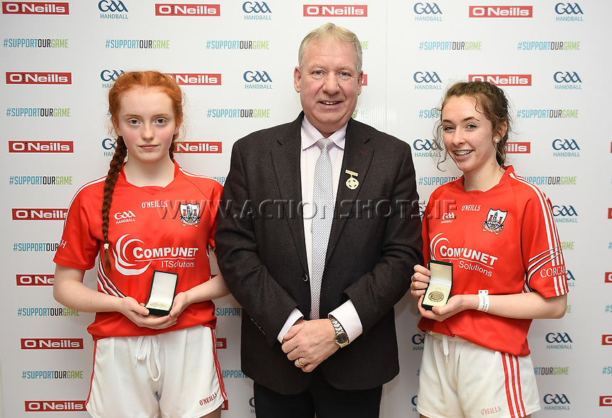 19/03/2018; 40x20 All Ireland Juvenile Championships Finals 2018; Kingscourt, Co Cavan;<br /> Girls Under-15 Doubles; Roscommon (Siobhan/Aishling Treacy) v Cork (Celine Kelleher/Muireann O&rsquo;Brien)<br /> Winners Celine Kelleher and Muireann O&rsquo;Brien with GAA Handball President Joe Masterson<br /> Photo Credit: actionshots.ie/Tommy Grealy