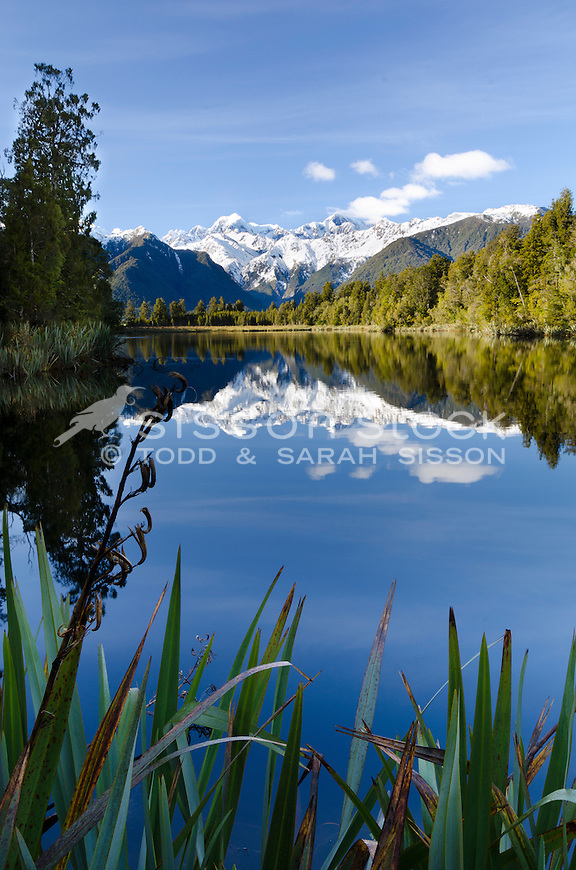 Lake Matheson morning reflection of Mt Cook / Aoraki and Mt Tasman from Reflection Point, South Westland, New Zealand