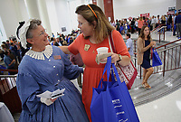 NWA Democrat-Gazette/DAVID GOTTSCHALK   Judy Costello (left), education manager at the Shiloh Museum of Ozark History, speaks Thursday, August 10, 2017, with Joan Threet, a teacher at Southwest Junior High School in Springdale, in the atrium of Springdale High School during the Springdale Chamber of Commerce's 51st annual Sam's Furniture Teacher Appreciation Day at Springdale High School. More than 2,000 educators were welcomed back and given the opportunity to visit with 64 vendors that included non-profit organizations, education organizations and local businesses and receive a chance to win door prizes among other activities.