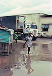 Walking through the puddles. Images of the capital,Port au Prince, Haiti 1975