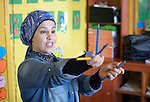 Rafeba Hussein teaches in a school in the Sabra refugee camp in Beirut, Lebanon, run by the Department of Service for Palestinian Refugees of the Middle East Council of Churches. Most of the school's 148 students are Syrian refugees, but roughly one-third are Palestinian refugees and a few are poor children from the neighborhood. Lebanon hosts some 1.5 million refugees from Syria, and yet the government prohibits the establishment of large refugee camps, thus pushing many refugee families to search for housing in existing Palestinian refugee camps. This school is supported by the ACT Alliance.
