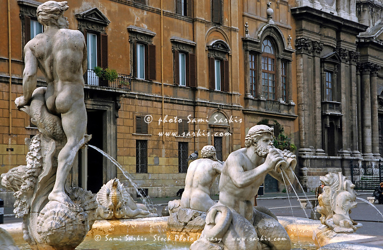 Statues on a water fountain, Piazza Navona, Rome, Italy.